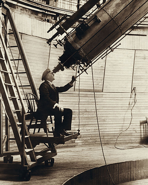 Lowell observing Venus in the Lowell Observatory, 1914.