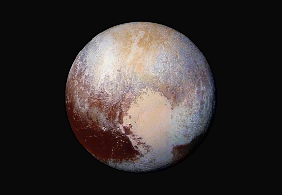 A false colour picture of Pluto. The hypothetical Planet Nine may be 75 times the distance from the Sun as Pluto, meaning light from the Sun would take up to a week to travel the distance.