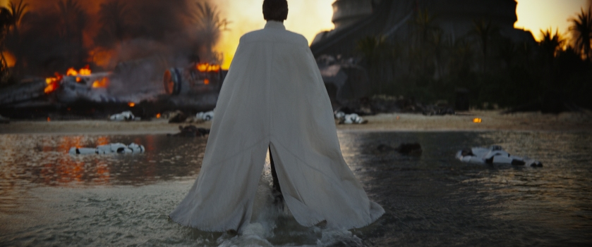 Director Orson Krennic strides across a shoreline in this still from the first trailer